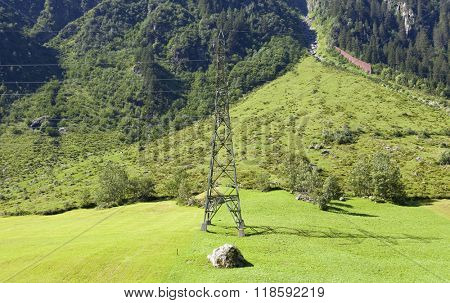 electricity pylons crossing the Swiss Alps. Bern Canton, Switzerland