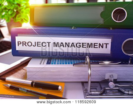 Project Management on Blue Office Folder. Toned Image.