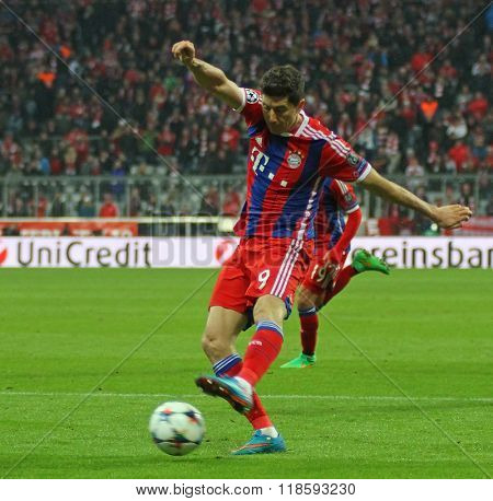 MUNICH, GERMANY - MARCH 11 2015: Bayern Munich's forward Robert Lewandowski takes a shot at goal during the UEFA Champions League match between Bayern Munich and FC Shakhtar Donetsk.
