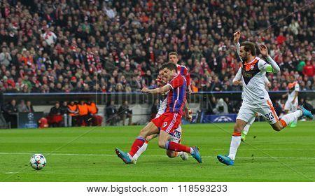 MUNICH, GERMANY - MARCH 11 2015: Bayern Munich's forward Robert Lewandowski scores a goal during the UEFA Champions League match between Bayern Munich and FC Shakhtar Donetsk.