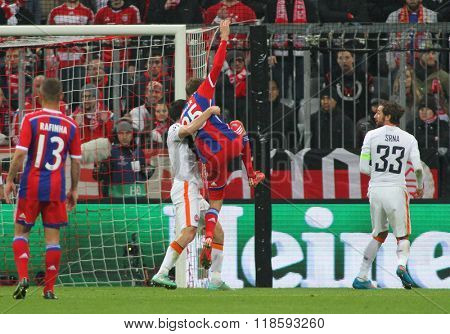 MUNICH, GERMANY - MARCH 11 2015: Bayern Munich's forward Thomas Muller gets man handled in the penalty box during the UEFA Champions League match between Bayern Munich and FC Shakhtar Donetsk.