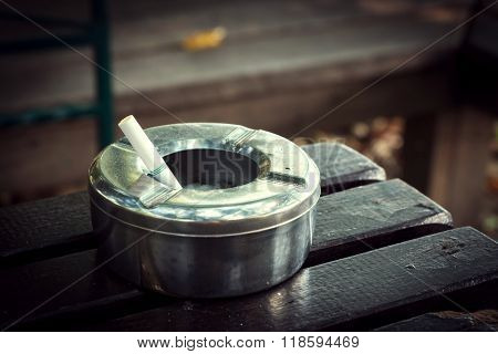 Cigarette Butt In Ashtray, Stainless Ashtray On Wood Table