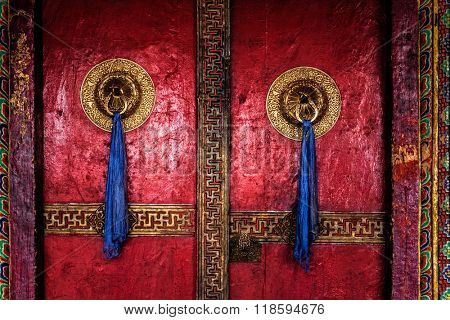 Gate of Spituk Gompa (Tibetan Buddhist monastery) with ornamented decorated door handles. Ladakh, India