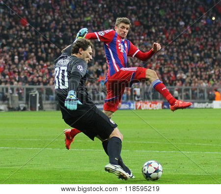MUNICH, GERMANY - MARCH 11 2015: Shaktar's goalkeeper Andriy Pyatov and Bayern Munich's forward Thomas Muller during the UEFA Champions League match between Bayern Munich and FC Shakhtar Donetsk