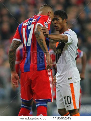 MUNICH, GERMANY - MARCH 11 2015:  Bayern Munich's defender Jerome Boateng and Shaktar's midfielder Douglas Costa face off during the UEFA Champions League match