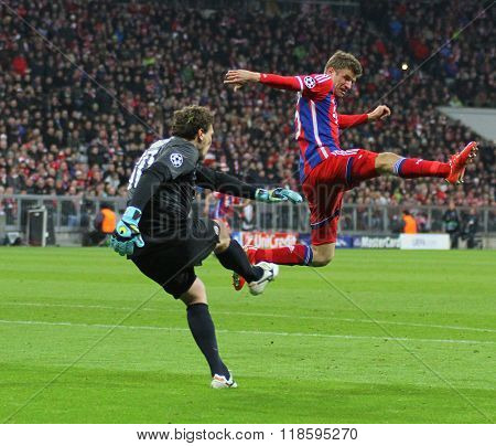 MUNICH, GERMANY - MARCH 11 2015: Shaktar's goalkeeper Andriy Pyatov and Bayern Munich's forward Thomas Muller during the UEFA Champions League match between Bayern Munich and FC Shakhtar Donetsk