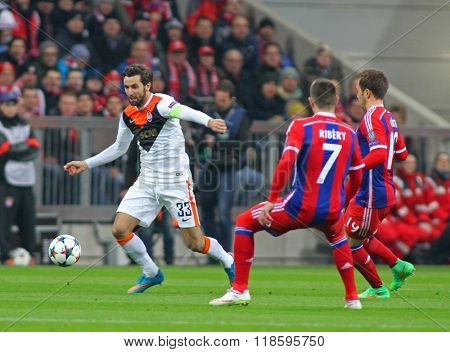 MUNICH, GERMANY - MARCH 11 2015: Shaktar's defender Darijo Srna Bayern Munich's midfielder Franck Ribery  and Mario Gotze   during the UEFA Champions League matc