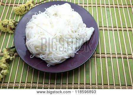 Thai rice vermicelli on green bamboo mat, Thai cuisine.