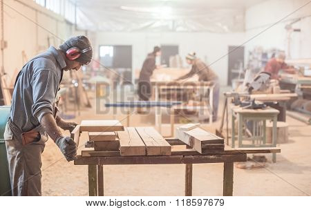 Man doing woodwork in carpentry