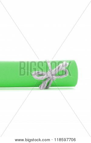 Handmade Natural String Knot Tied On Green Letter Roll Isolated