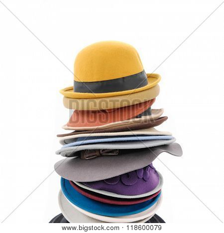 Stacked of fedora hat isolated on white