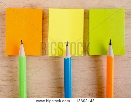 Colorful Pencils Put On The Colorful Notepads On The Wooden Plate