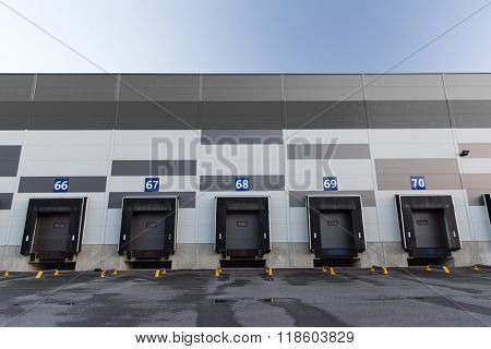 logistic, storage and shipment concept - warehouse gates