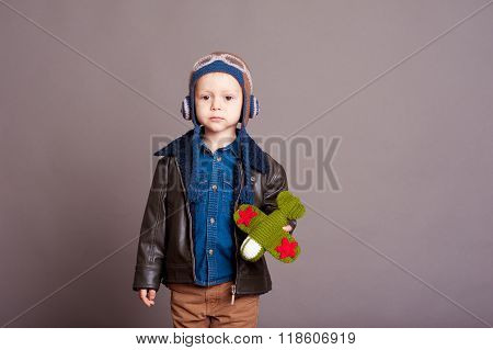 Cute kid boy holding toy