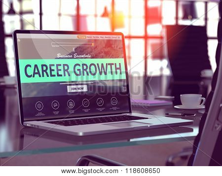 Career Growth on Laptop in Modern Workplace Background.