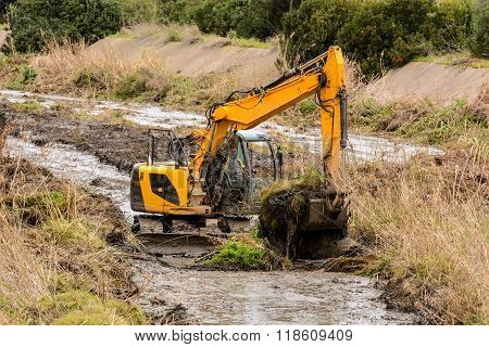 Excavators In The River.