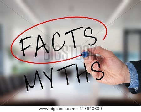 Businessman Hand Drawing And Choosing Facts Instead Of Myths