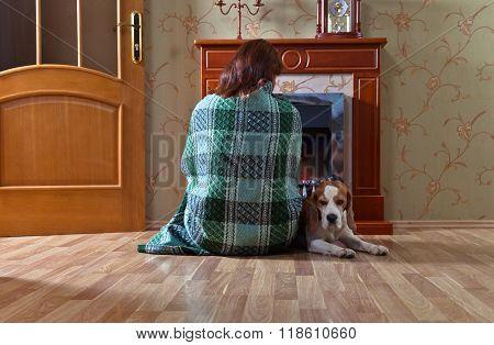 Woman With  Dog Near A Fireplace