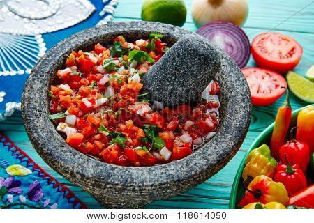 Pico de Gallo sauce from Mexico with tomato cilantro and onion in molcajete