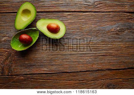 avocado cut on aged wood table board half cut