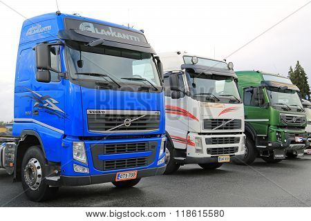 Three Colorful Volvo Trucks