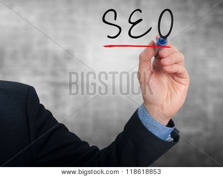 The Businessman Is Writing Seo On The Transparent Board