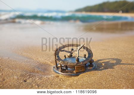 panorama of tropical beach with old vintage sundial