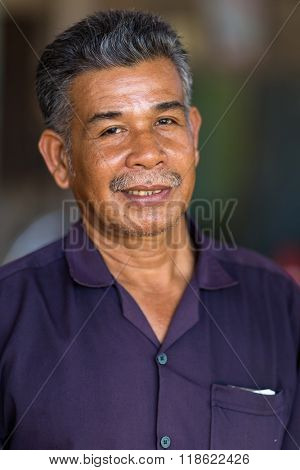 Portrait of a Thai mechanic turner in his workshop, Thailand