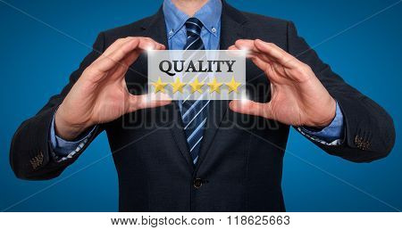 Businessman Holding White Card With Quality Five Stars Sign, Blue - Stock Photo