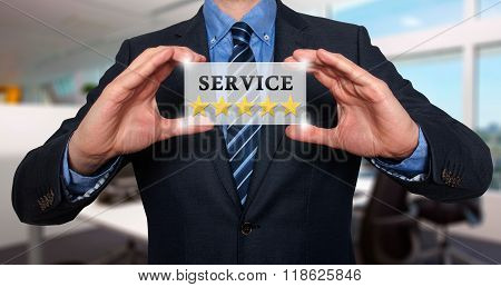 Businessman Holding White Card With Service Five Stars Sign, Office- Stock Photo