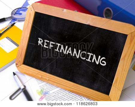 Handwritten Refinancing on a Chalkboard.