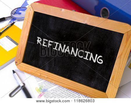 Handwritten Refinancing on a Chalkboard.