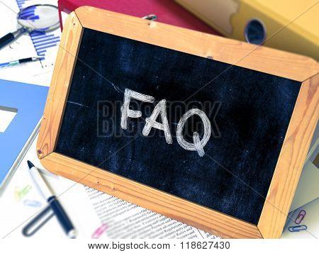 Hand Drawn FAQ Concept on Small Chalkboard.