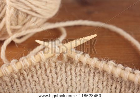 knitting needles in process of knitting