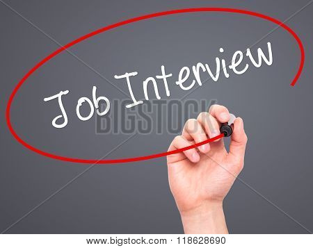 Man Hand Writing  Job Interview With Black Marker On Visual Screen