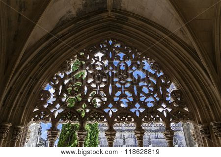 Batalha, Portugal - July, 2015: Stonework on the Royal Cloister of the Batalha Abbey. Crosses of Christ used in the decoration. Masterpiece of the Gothic and Manueline art. UNESCO World Heritage Site.