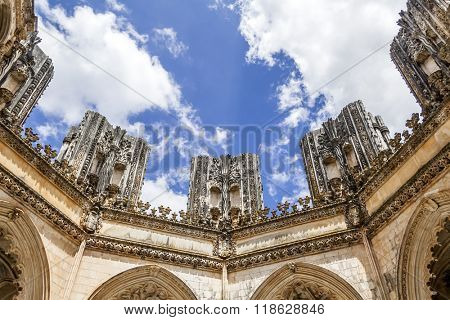 Batalha, Portugal - July, 2015: Looking up, inside the Unfinished Chapels (Capelas Imperfeitas) of the Batalha Monastery. A masterpiece of the Gothic and Manueline. Unesco World Heritage.