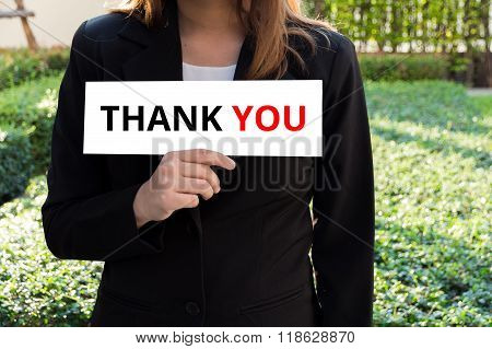 Businesswoman Showing White Sign With Thank You Word.