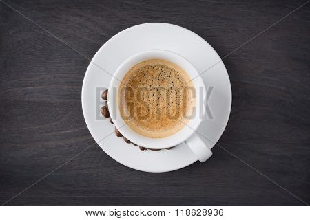 Coffee cup top view on wooden table background
