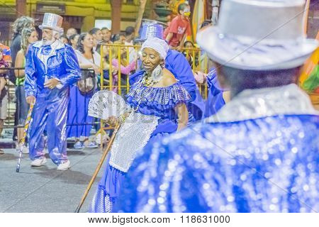 Group Of Costumed Seniors Marching At Carnival Of Uruguay