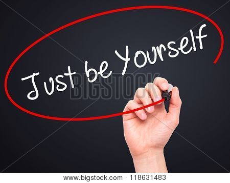 Man Hand Writing Just Be Yourself With Black Marker On Visual Screen