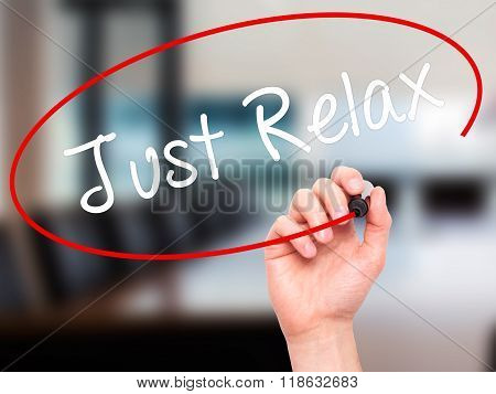 Man Hand Writing Just Relax With Black Marker On Visual Screen