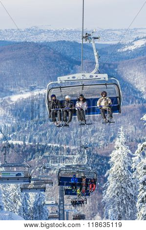 Tourists In Chairlift