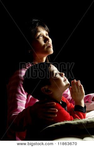 Mother and son saying prayers.