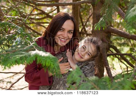 Mother And Kid Hide Amonge Tree Branches
