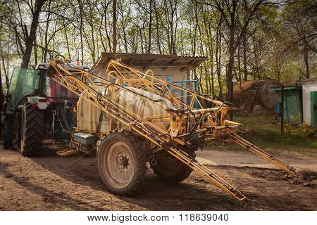 Trailer Fertilizer-sprayer On Farm Yard Near House