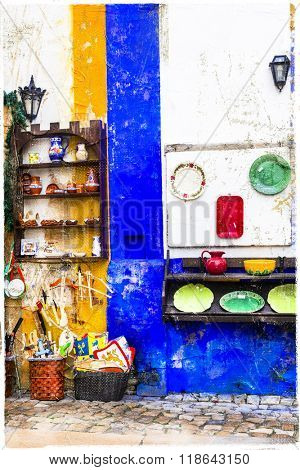 colorful shops of old town Obidos in Portugal, artistic picture