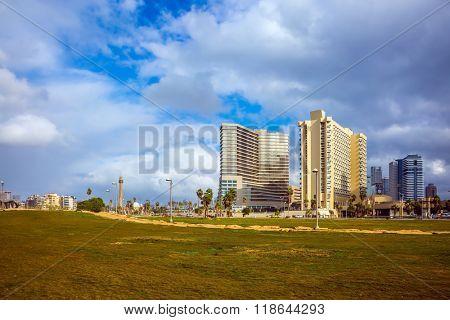 TEL AVIV, ISRAEL - JANUARY 1, 2016:  Windy and bright winter day on the sea coast. Skyscrapers on the embankment of Tel Aviv
