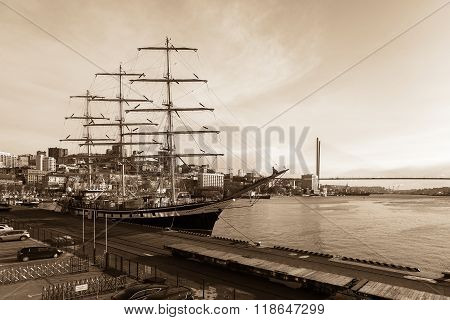 Sailing ship Pallada moored to the Sea port of Vladivostok
