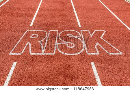 Risk written on running track